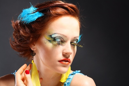 eyeshades: Gorgeous Young model beautiful women with perfect art make up and long false eyelashes made from feathers Stock Photo