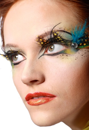 Gorgeous Young model beautiful women with perfect art make up and long false eyelashes made from feathers photo