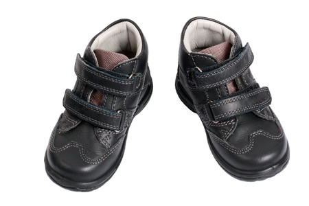 kids shoes from the black leather isolated on white background with copy-space photo