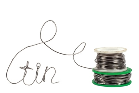 bendable: Thick roll of thin welding wire - wire in foreground in focus roll in background out of focus with text from wire Stock Photo