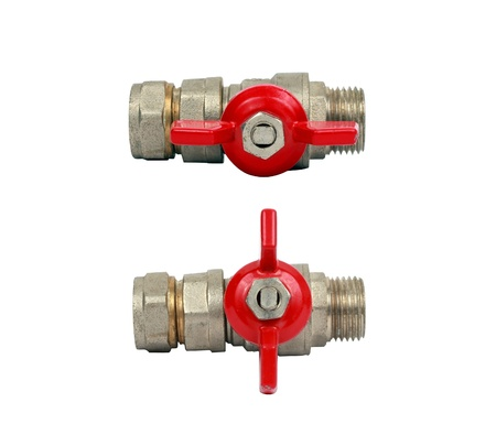 two water ball valves isolated. One is opened and another is closed. photo