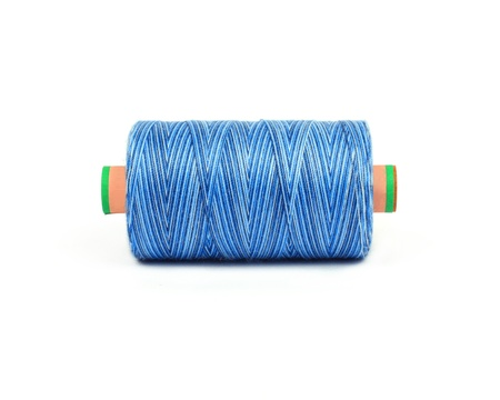 light blue bobbin of professional threads for machine embroidery multicolor melange photo