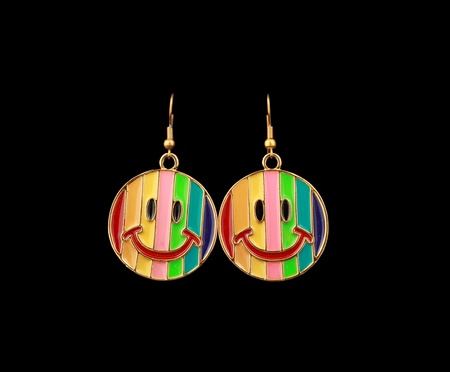 funny Earrings Smile faces isolated over black background with clipping path easy to edit Stock Photo - 13401160