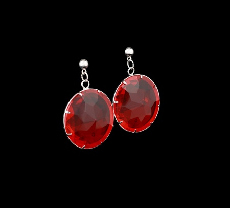 silver earrings with red stones isolated on a black background Stock Photo - 13401157