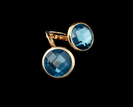 gold earrings with blue stones isolated on a black background Stock Photo - 13401155