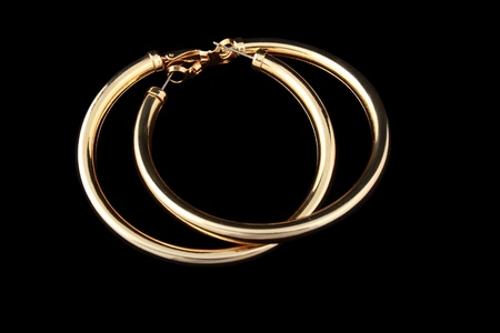 gold curcle earrings  isolated on a black background Stock Photo - 13401177