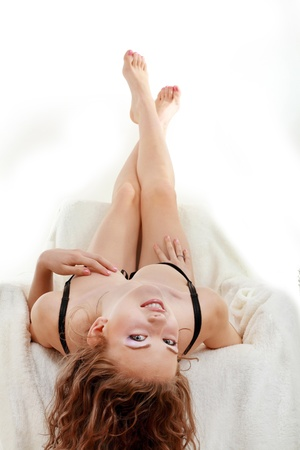 portrait of beautiful sexy young women in underwear women lying upside down photo