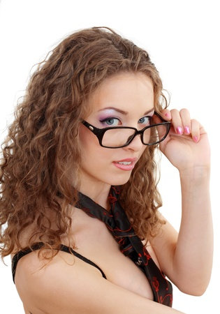 beautiful young woman in black underwear and tie  looking over glasses close up over white background Stock Photo - 13401419