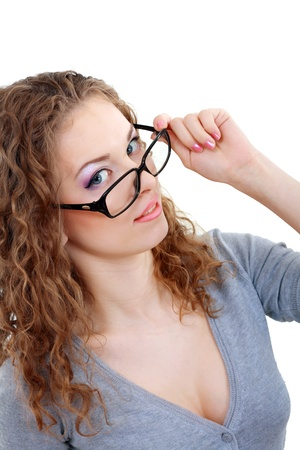 beautiful young woman face with perfect make up looking over glasses over white background photo
