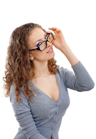 black hair blue eyes: beautiful young woman face with perfect make up looking over glasses over white background