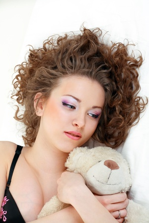 Beautiful girl close up laying and relaxing in the bed Stock Photo - 13401422