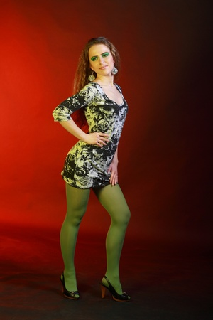 Young pretty woman in jersie dress photo