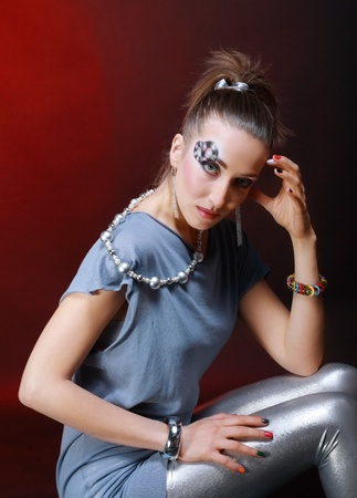Young pretty woman with art make up disco theme photo