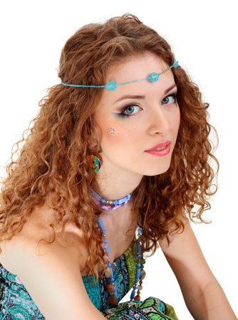 beautiful young woman face close up with hippie art make up and false eyelashes photo