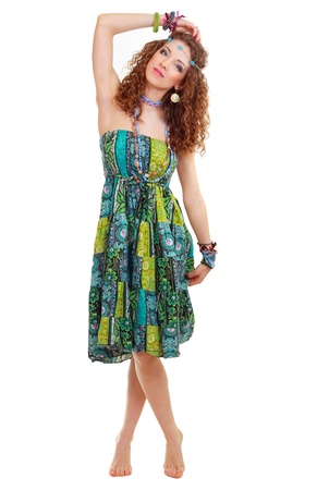 hippie woman: beautiful young hippie woman in hippie outfit green dress standing bootlessly in full-length isolated