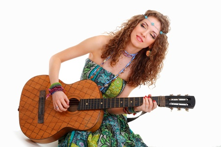 Beautiful Girl playing guitar on white background in hippie outfit isolated photo