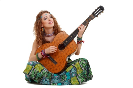 Beautiful Girl playing guitar on white background in hippie outfit isolated Stock Photo - 13401292