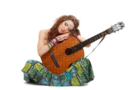 Beautiful Girl holding guitar on white background in hippie outfit isolated photo