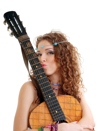 Beautiful Girl loving her old guitar on white background in isolated Stock Photo - 13401343