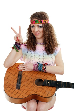 Beautiful woman holding her old guitar in hippie outfit on white background isolated Stock Photo - 13401380