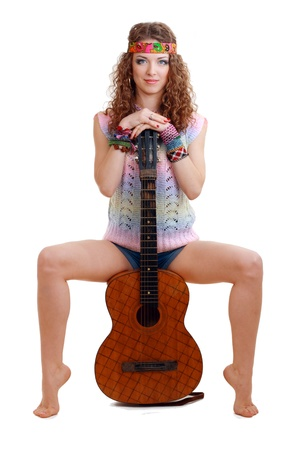 Beautiful Girl sitting on guitar on white background in isolated Stock Photo