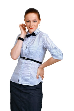 Young woman wearing shirt and bow tie isolated on white  Stock Photo - 13401338