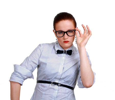 portrait of young business woman or teacher wearing eye-glasses and hold them by hand, isolated on white background Stock Photo - 13401251