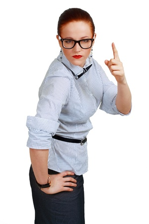 portrait of young business woman or teacher wearing eye-glasses the index finger up Stock Photo - 13401318