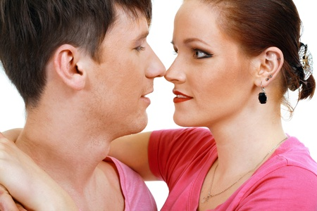 Portrait of a romantic young couple about to kiss each other Stock Photo - 13401488
