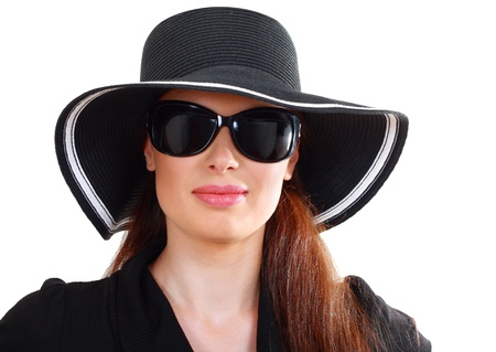 beautiful woman in black sunglasses and black hat photo