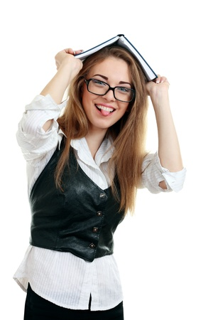 Young happy woman (student) with books on her head in glasses showing tongue , isolated on white photo