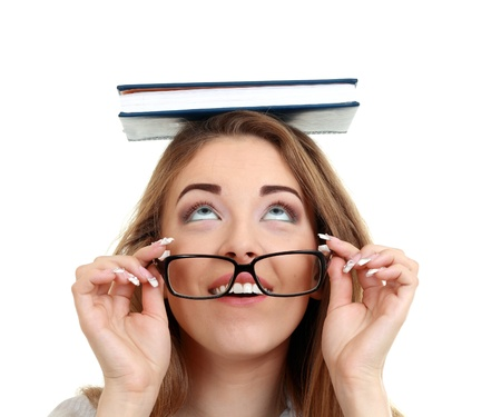Happy young beautiful woman wearing book on her head wearing eye glasses Stock Photo - 13876422