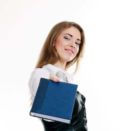 An isolated shot of a beautiful student girl or business woman showing a book with blank cover making presentation Stock Photo - 13876097