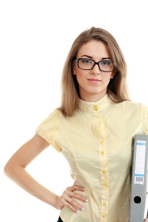 Beautiful young woman posing in business suit and glasses holding folder. Isolated over white background Stock Photo - 13876505
