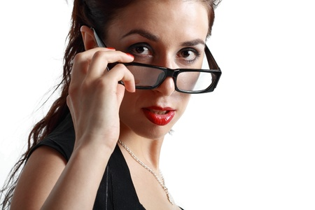 beautiful brunette woman face looking over glasses over white background photo