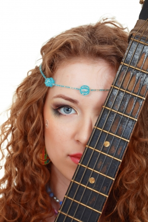 Beautiful Girl holding guitar on white background close up photo