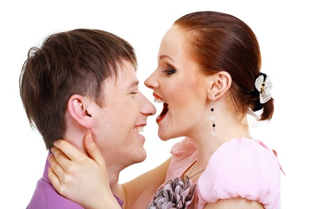 Portrait of a romantic young couple about to kiss each other photo
