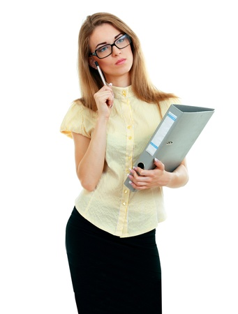 Young business woman or teacher thinking with a document folder in yellow shirt and glasses photo