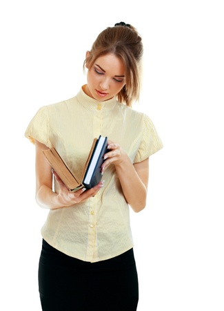 College Student girl. Isolated full length portrait of a beautiful young caucasian woman student looking at book seriousely Stock Photo - 14030340