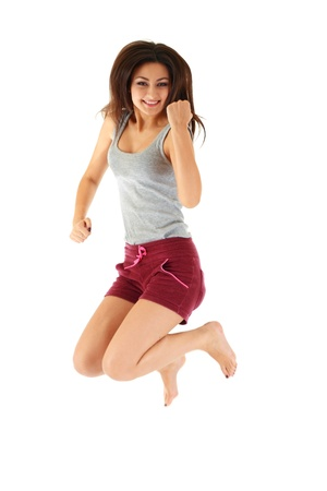 young woman jumping on white background  photo