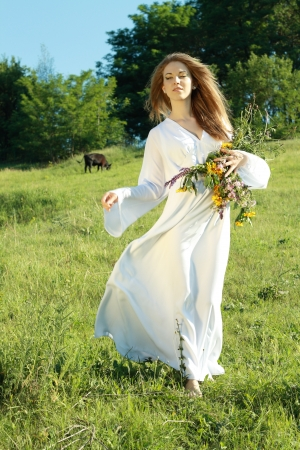 Portrait of the young beautiful woman outdoors. she looks like an angel photo