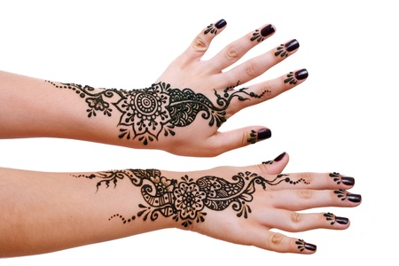Image detail of henna being applied to two hands
