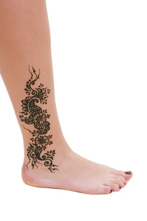 Image detail of henna being applied to leg photo