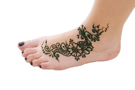 bodyart: Image detail of henna being applied to leg Stock Photo