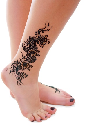 tattoo: Image detail of henna being applied to leg Stock Photo