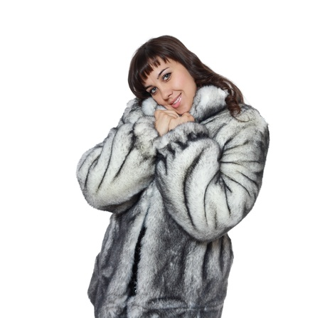 beautiful woman in fashionable silver grey fur coat - isolated on white photo