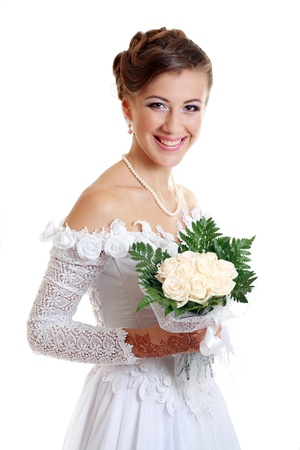 Beautiful young woman in white dress and pearl necklace beige background with henna tatoo applyed to her hands and with wedding bouquet Stock Photo - 14284205