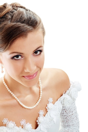 Beautiful young bride in white dress and pearl necklace beige background Stock Photo - 14284236