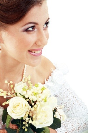 Beautiful young bride in white dress and pearl necklace isolated on white background Stock Photo - 14284250