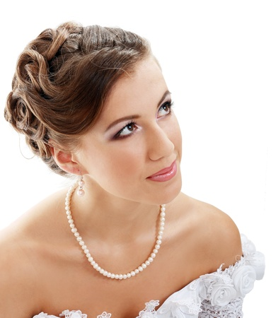 Beautiful young bride in white dress and pearl necklace isolated on white background Stock Photo - 14284202